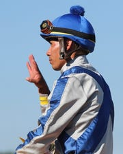 Jockey Jose Ortiz, shown here in a file photo at Delaware Park, suffered a fractured wrist on Saturday at Gulfstream Park after being tossed from a first-time starter named Atone in the post parade before the third race. He'll be out a few weeks and the injury will prevent Ortiz from riding Tacitus for trainer Bill Mott in the $20 million Saudi Cup on Feb. 29 in Saudi Arabia.
