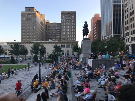 Protesters gather together in Rodney Square to protest Trump's immigration policies.