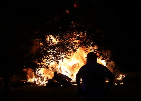 A vehicle burns after leaving Pole Bridge Road and striking a tree in an accident that left at least one person dead about 8:50 p.m. Friday north of Odessa.