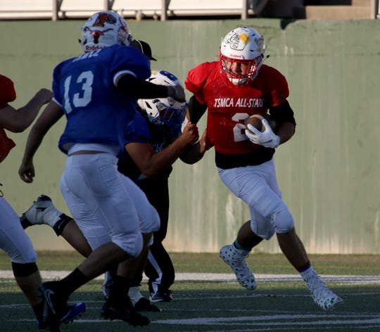 East's Skylar Hayes, Coolidge, runs along the sideline against the West Friday, July 12, 2019, in the Texas 6-Man Coaches Association DI all-star football game at Memorial Stadium.