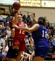 Newcastle's Arryn Eli shoots over Grandfalls-Royalty's Ariana Crook Saturday, July 13, 2019, in the Texas 6-man Coaches Association all-star game in D.L. Ligon Coliseum at Midwestern State University.