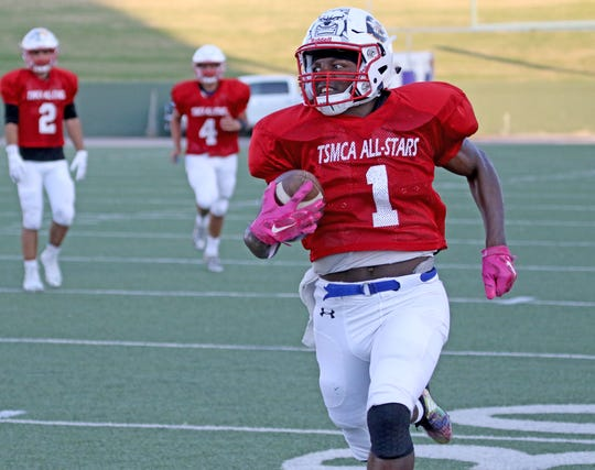 East's TaRon Smith, Milford, runs along the sideline against the West Friday, July 12, 2019, in the Texas 6-Man Coaches Association DI all-star football game at Memorial Stadium.