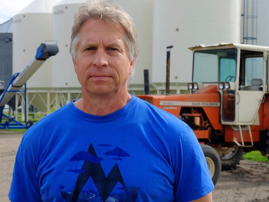 In this July 1, 2019, photo, Mark Askegaard poses for a photo at organic farm farm about 3 miles from the Red River, also near Comstock, Minn. Askegaard opposes the proposed Fargo-Moorhead diversion project, which would flood some of the land where he grows organic crops.