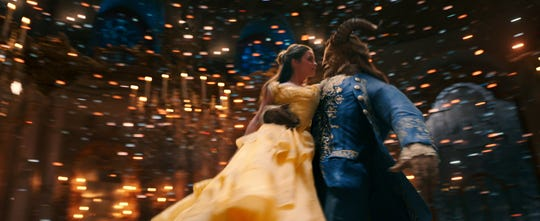 "Belle (Emma Watson) is won over by the monstrous Beast (Dan Stevens) in ""Beauty and the Beast."""
