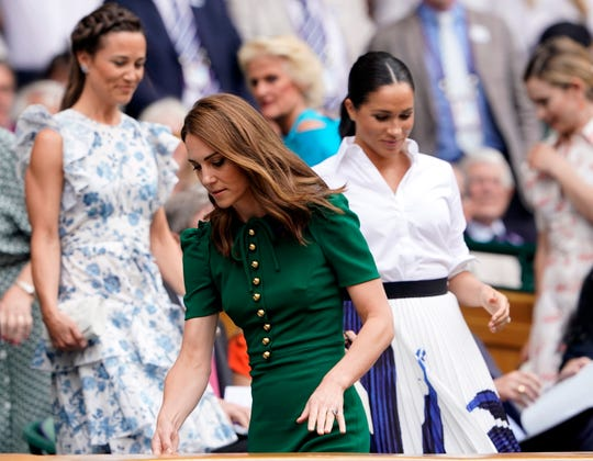 Pippa Middleton, Duchess Kate and Duchess Meghan at Wimbledon on July 13, 2019.
