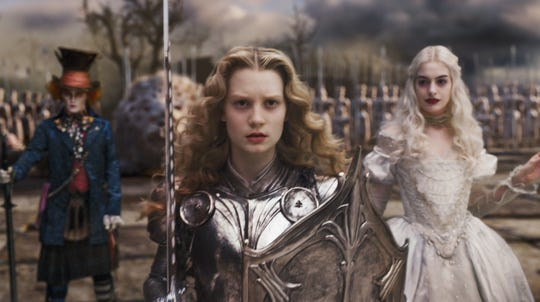 "Young Alice (Mia Wasikowska, center) leads the troops, including Mad Hatter (Johnny Depp) and the White Queen (Anne Hathaway), in ""Alice in Wonderland."""