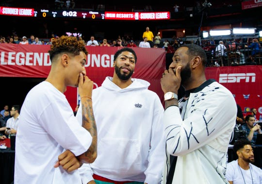 Jul 6, 2019: Los Angeles Lakers players Kyle Kuzma (left), Anthony Davis (center) and Lebron James talk prior to the game against the Los Angeles Clippers during the NBA Summer League.