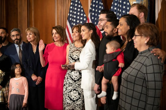 House Speaker Nancy Pelosi swears in Rep. Alexandria Ocasio-Cortez , D-N.Y., on Jan. 3, 2019 at the U.S. Capitol in Washington, D.C.