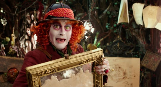 "Johnny Depp returned as the Mad Hatter in the fantasy sequel ""Alice Through the Looking Glass."""
