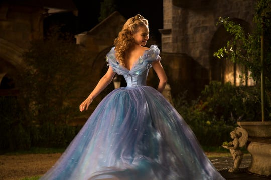"Lily James wears a spiffy ball gown as the title character of ""Cinderella."""