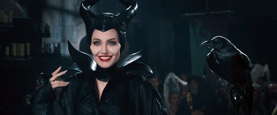"Maleficent (Angelina Jolie) holds court as more than just a villain in the ""Sleeping Beauty"" revamp ""Maleficent."""