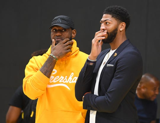Los Angeles Lakers forwards LeBron James and Anthony Davis talk after a Saturday press conference.