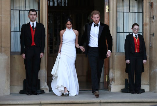 Duchess Meghan and Prince Harry, leave Windsor Castle after their wedding to attend an evening reception at Frogmore House, hosted by the Prince of Wales, Saturday, May 19, 2018.