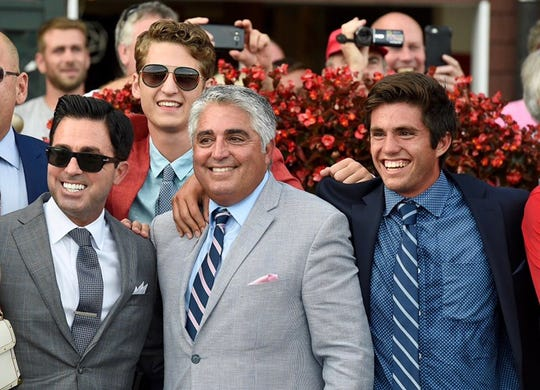 The Sacco family celebrates in the winner's circle at Saratoga after Mind Control won the Grade 1 Hopeful Stakes last year, including Red Oak Stable racing manager Rick Sacco (left), and trainer Gregg Sacco (center).
