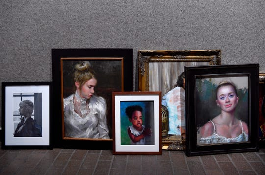 Portraits are grouped as they await to be hung in the main gallery of the Breckenridge Fine Arts Center on Thursday.