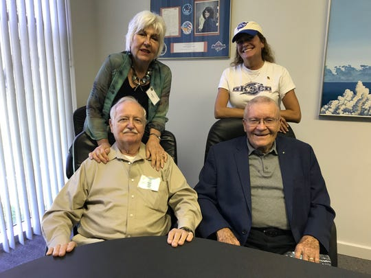Apollo 13 astronaut Fred Haise, right front, is pictured at an Apollo-era workers reunion with NASA engineer Charlie Mars and, in back, Mars' wife, Barbara, and daughter, Shelly.