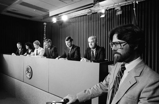 "Steve Nesbitt, a Ray High School graduate, leads a NASA preflight press conference with the STS-41D crew Aug. 17, 1984, at the Johnson Space Center. Crewmembers visible, right to left, are: Henry W. Hartsfield Jr., crew commander; Michael L. Coats, pilot; Richard M. Mullane, Steven A. Hawley and Judith A. Resnik, mission specialists: and Charlie D. Walker, payload specialist. Nesbitt, a public affairs officer, was also the ""voice of mission control,"" narrating the take-offs of space missions in the 1980s."