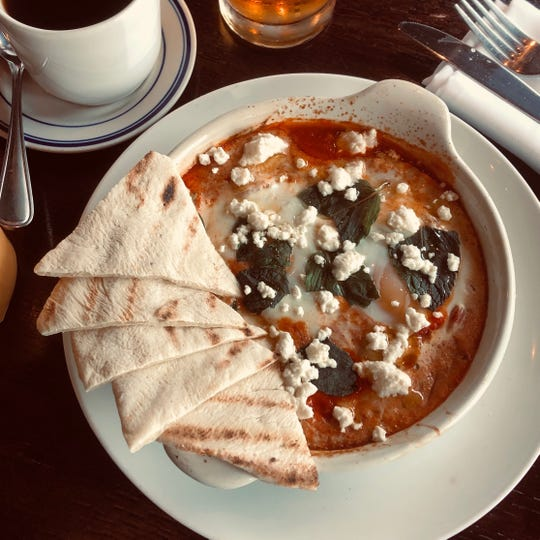 Shakshuka, shown here with warm pita, shows up on the Farm & Fisherman Tavern menu as a brunch special in cooler months.