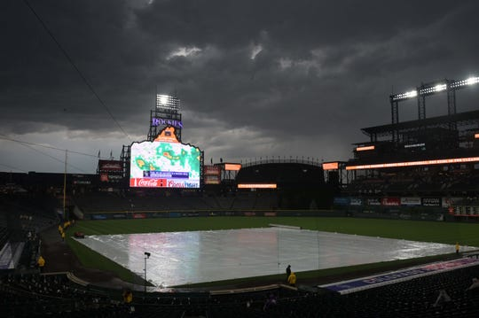Jul 13, 2019; Denver, CO, USA; Rain and lightning delay at Coors Field during the MLB game between the Cincinnati Reds and the Colorado Rockies. Mandatory Credit: Kirby Lee-USA TODAY Sports
