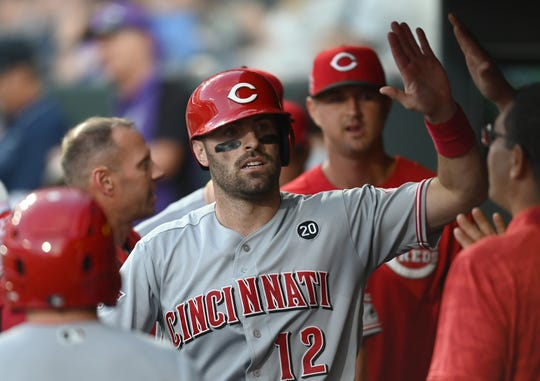 Jul 12, 2019; Denver, CO, USA; Cincinnati Reds catcher Curt Casali (12) celebrates scoring in the sixth inning against the Colorado Rockies at Coors Field. Mandatory Credit: Ron Chenoy-USA TODAY Sports