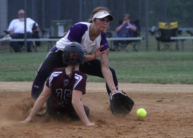 Indianola sophomore shortstop Destiny Lewis takes a throw from the outfield as West Des Moines Dowling freshman Sarah Hochberger slides into second.