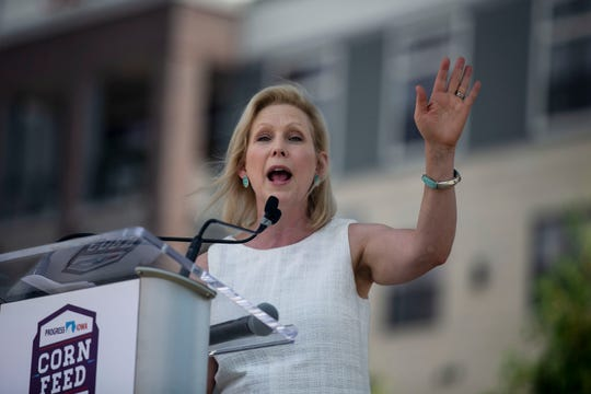 U.S. Sen. Kirsten Gillibrand, D-NY, speaks to the crowd at the annual Progress Iowa Corn Feed on Sunday, July 14, 2019, outside of New Bo City Market in Cedar Rapids.