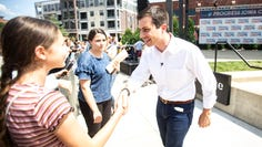 Pete Buttigieg, Mayor of South Bend, Indiana, shakes hands with a supporter during Progress Iowa Corn Feed, Sunday, July 14, 2019, the Newbo City Market in Cedar Rapids, Iowa.