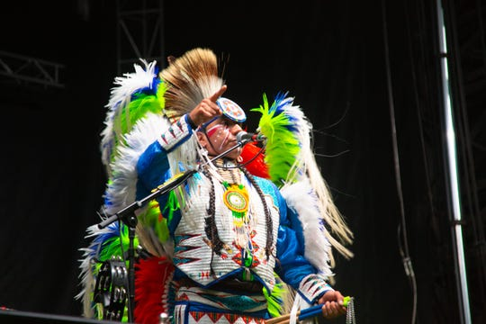A representative of Iowa's Meskwaki tribe dances before Portugal. The Man performs at the 80/35 music festival Saturday, July 13, 2019.