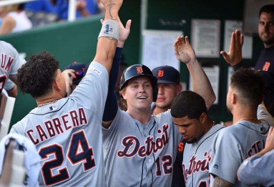 Detroit Tigers' Brandon Dixon celebrates with teammates after scoring in the second inning against the Kansas City Royals at Kauffman Stadium on July 13, 2019 in Kansas City.