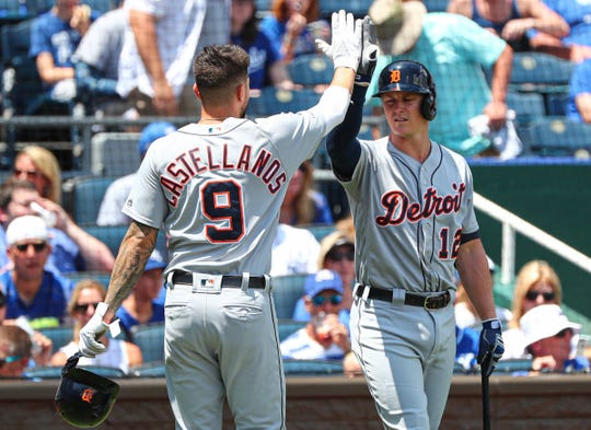 Detroit Tigers designated hitter Nicholas Castellanos celebrates with first baseman Brandon Dixon after scoring against the Kansas City Royals during the first inning at Kauffman Stadium, Sunday, July 14, 2019, in Kansas City.