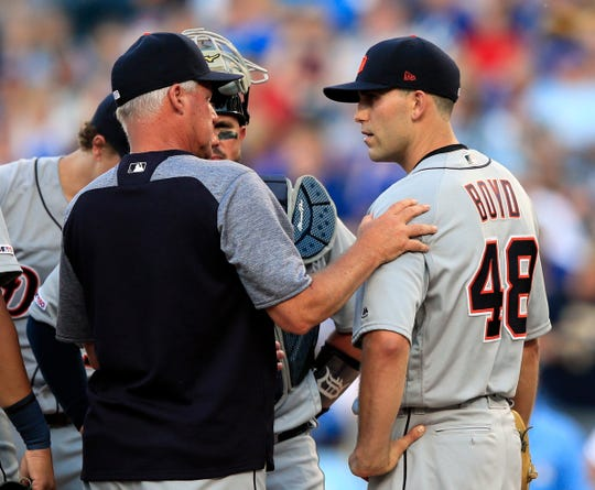 Detroit Tigers starting pitcher Matthew Boyd talks with pitching coach Rick Anderson during the fifth inning against the Kansas City Royals at Kauffman Stadium in Kansas City, Saturday, July 13, 2019.