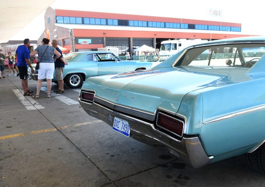 A 1967 Buick Special Deluxe parks next to a 1966 Chevrolet Caprice, left, at Motors at the Market at Eastern Market in Detroit on Sunday.