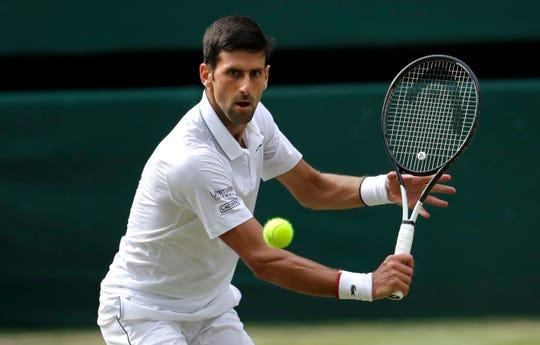 Novak Djokovic returns the ball to Roger Federer during Sunday's final.