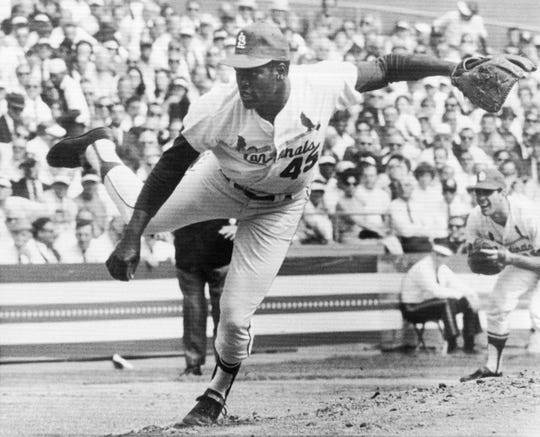 Bob Gibson pitches against the Detroit Tigers in Game 1 of the 1968 World Series.