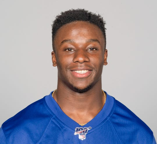 This May 2019 photo shows Corey Ballentine of the New York Giants NFL football team. An 18-year-old Kansas man has been charged in the April attack that wounded Ballentine and killed one of his Washburn University teammates, Dwane Simmons. Francisco Alejandro Mendez was charged Friday with first-degree murder, attempted first-degree murder and five counts of aggravated battery in the April 28 attack, the Shawnee County district attorney's office said in a news release.