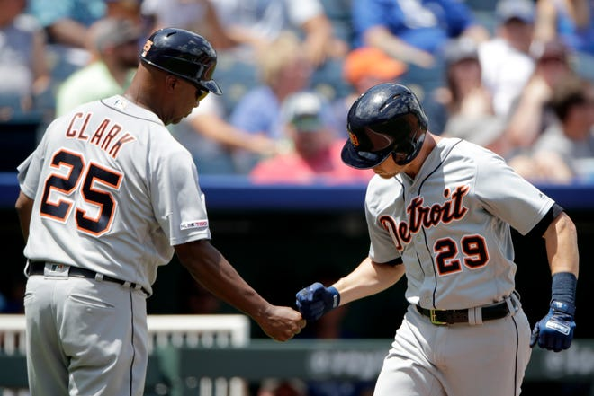 Detroit Tigers' Gordon Beckham (29) celebrates with third base coach Dave Clark (25) after hitting a two-run home run during the third inning.