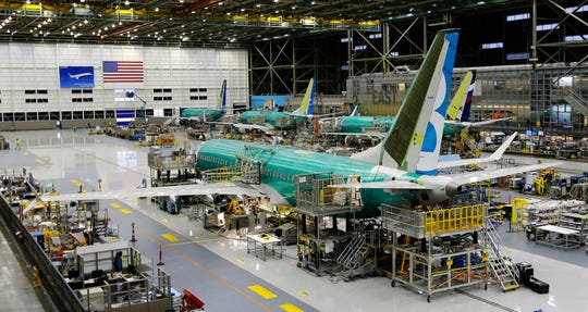 This Dec. 7, 2015, file photo shows the second Boeing 737 MAX airplane being built on the assembly line in Renton, Wash. American Airlines says it will keep the Boeing 737 Max plane off its schedule until Nov. 3, 2019, which is two months longer than it had planned.