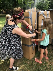 About 30 community members gathered to create cardboard castles to support Queer Space, a local community organization working toward eliminating LGBTQ stigma.