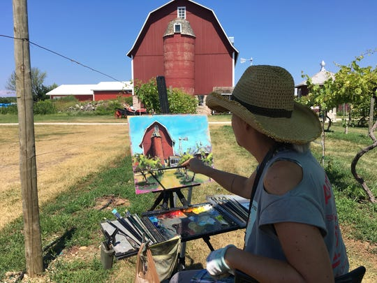 Shelby Keefe of Milwaukee paints a barnscape during the 2018 Door County Plein Air Festival. Keefe returns this year as one of 38 painters from across the country who will work outdoors for the public to watch during next week's festival.