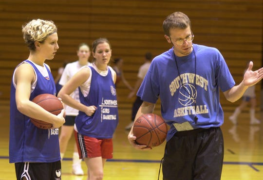 Former Green Bay Southwest guard Berri West (left, with ball in hand) was coached by her brother, Riley, right, in the early 2000s.