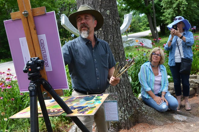 Spectators watch artist Andre Lucero painting a scene during the 2018 Door County Plein Air Festival. Thirty-eight painters from across the country will work outdoors for the public to watch during next week's festival.