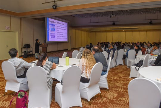 Virgina McMahon, a consultant for the University of Hawai'i Community Colleges, gives a presentation during the Guam Cancer Clinical Trial Symposium at the Hotel Nikko Guam Tasi Ballroom in Tumon, July 14, 2019.