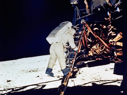 "Astronaut Edwin ""Buzz"" Aldrin descends steps of the Lunar Module ladder on July 20, 1969. This photo was made by astronaut Neil Armstrong with a 70mm surface camera."
