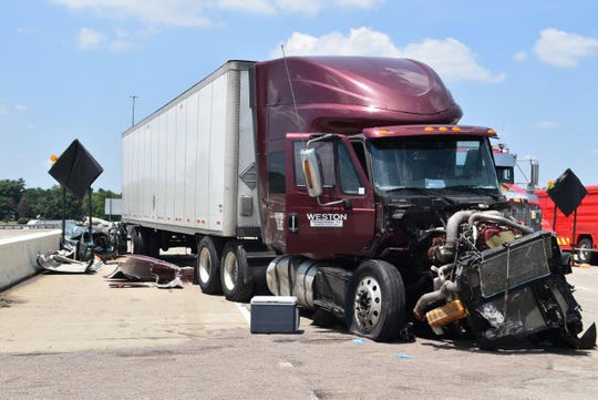 A seven-car crash on I-465 closed all eastbound lane and left three dead.