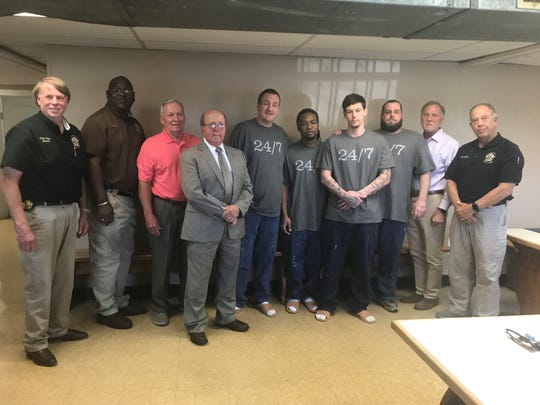 Local officials and Inside Out Dads graduates celebrate their accomplishment together at the Madison County Penal Farm.