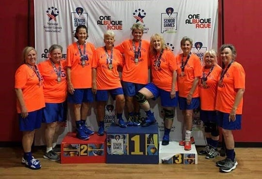 The West Tennessee Madisons celebrate their national championship after receiving their medals in New Mexico last month.