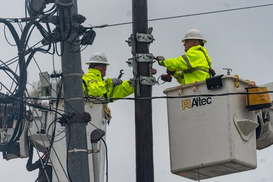 Work crews making repairs in Lafayette, LA as Tropical Storm Barry approaches South Louisiana. Saturday, July 13, 2019.