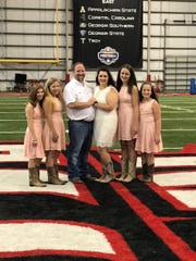 Casie Falcon and Garland Young Jr. were married Saturday morning on the 50-yard line of the UL Lafayette indoor practice field due to Hurricane Barry. With them are their children Ashley Young, Elizabeth young, Kailey Bennett and Demi Bennett.