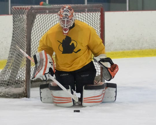 """Goalie Jerry Kuhn, who is 33, is known as """"dad"""" by his much-younger teammates in the Made in Michigan Elite League at Kensington Valley Ice House in Brighton."""