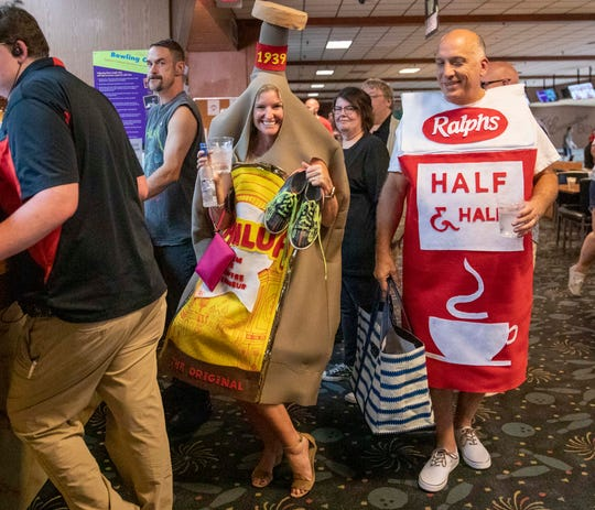 Phyllis Goodson dressed as a Kahlua bottle, grabs her shoes and heads for her bowling lane at the Lebowski Festival held at Executive Strike and Spare Saturday, July 13, 2019 in Louisville, Ky.